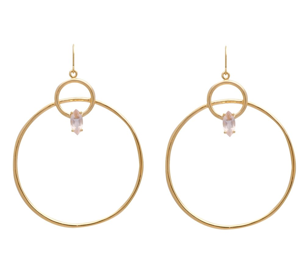 The Melody earrings in gold:They are that simple statement item that you've been waiting for. In your choice of Tourmalinated Quartz or Rose Quartz, they look great with all the floral patterns and feminine boho looks of the season.