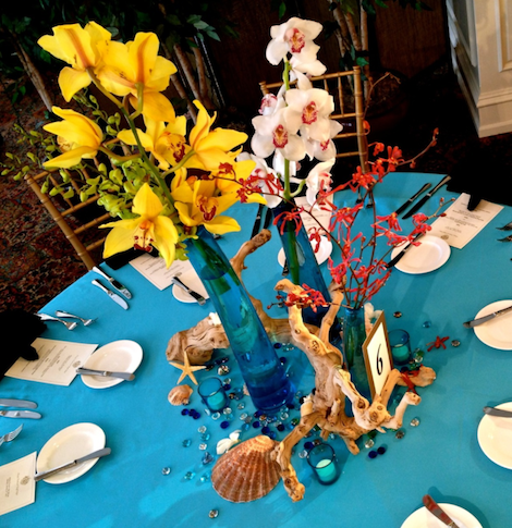Tropical Floral Centerpiece by Eggsotic Events.png