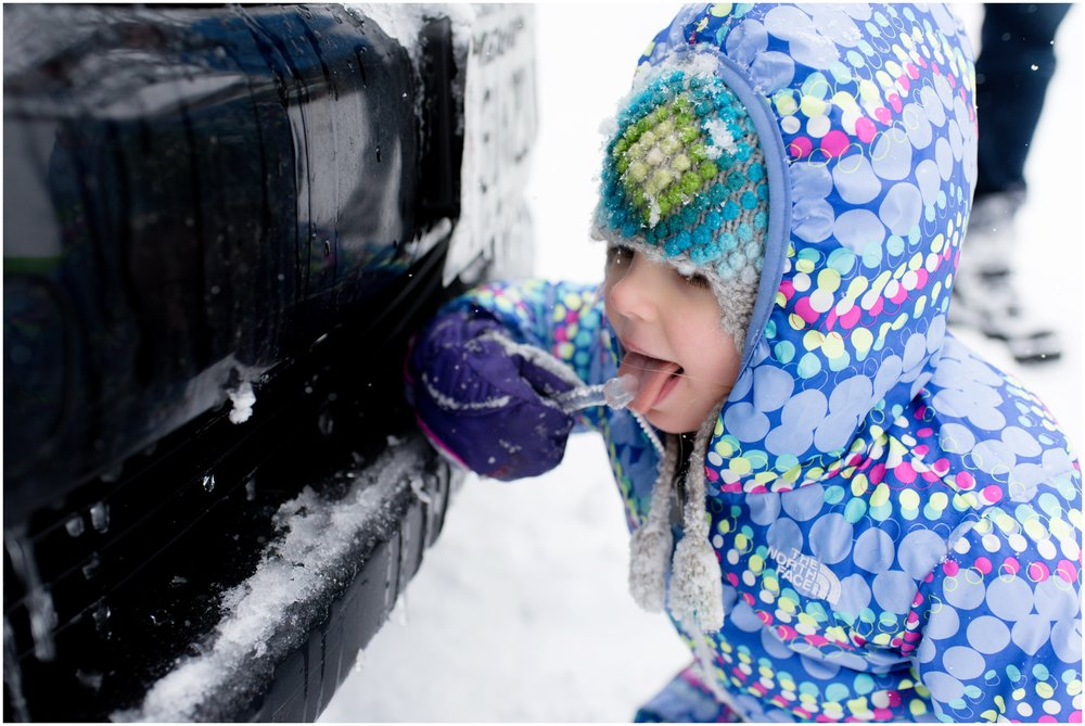 little girl licking ice