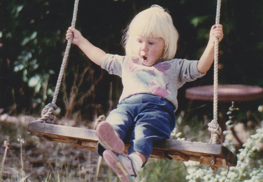 This is my favorite photo of myself as a small child.  I don't remember this moment, but I can imagine how I felt - totally independent and free!  A little bitty kid on a great big swing.  This picture feels like childhood to me.
