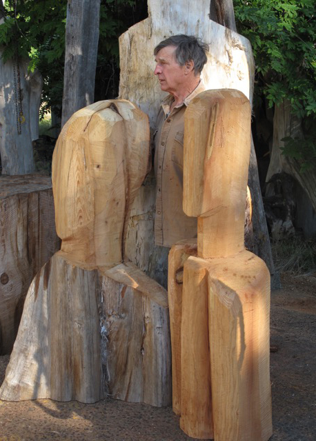 The artist with two works in cedar outside Denman Island studio.