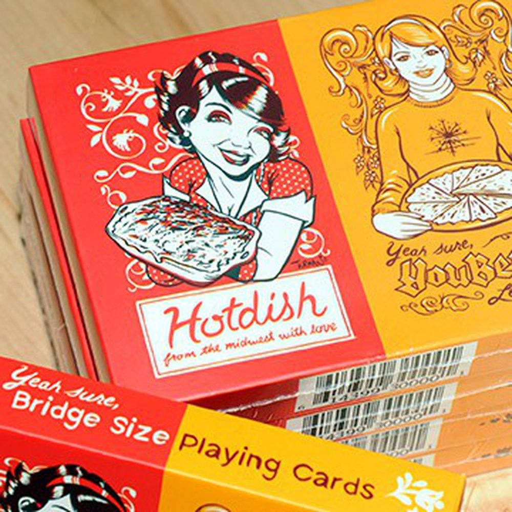 Hotdish & YouBetCha Bridge-sized / Double Playing Card set     High-  q  uality premium linen  Bridge-sized (slightly less wide than traditional Poker Playing cards to hold more cards easliy) playing card set that includes 2 decks. The backs of each deck are customized with Hotdish and YouBetCha images as are Ace of Spades and Joker cards (using the Uff-Da image).  They feel, shuffle, slide, and play extremely well.