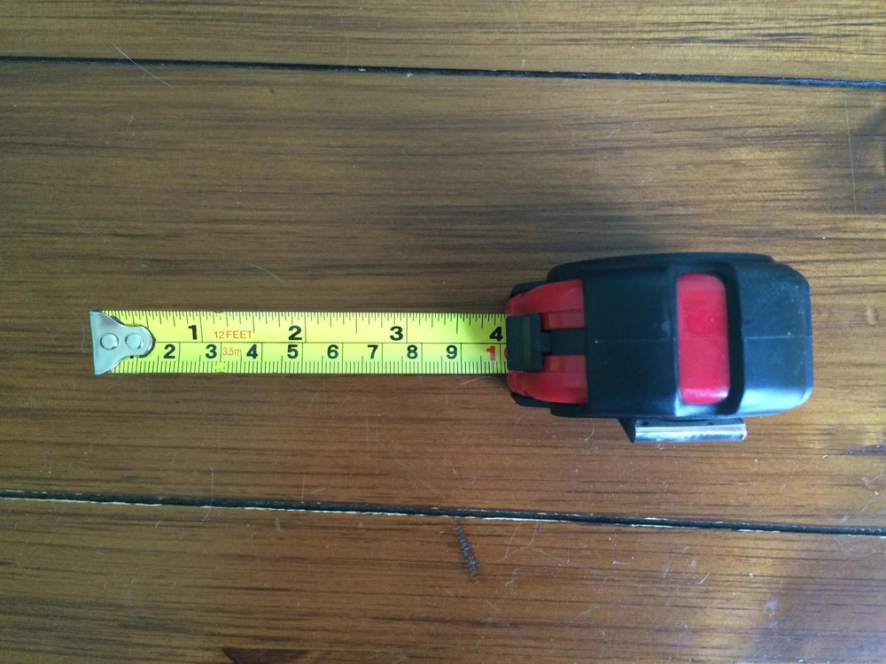 Fix your measuring tape at the 4 inch mark to check for spaces larger than 4 inches around the window guard.
