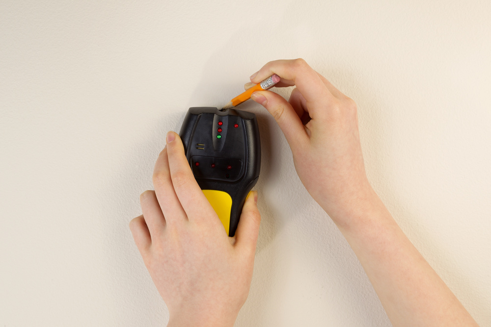 Stud finder in a wall to mount your TV