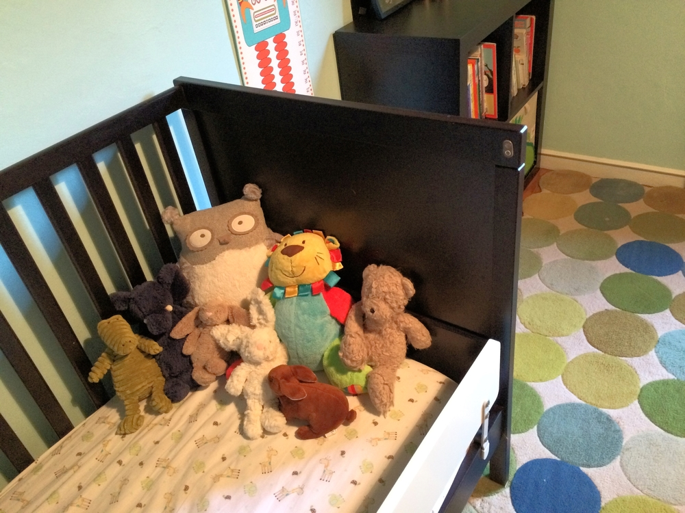My son's converted crib to bed and lots of friends!