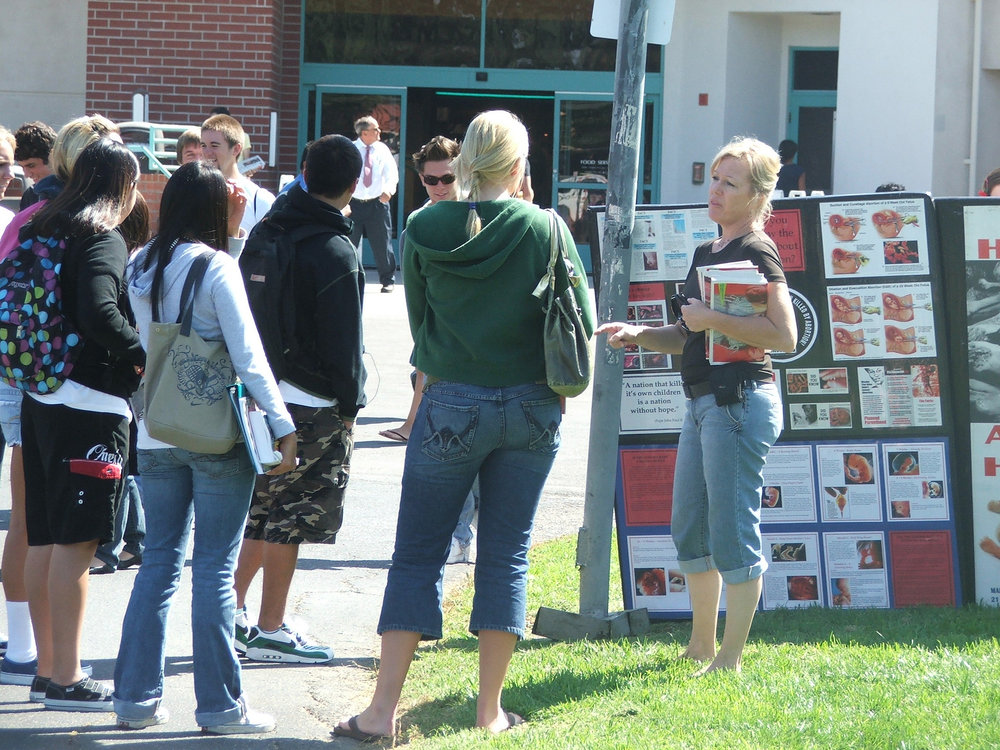 Cheryl Conrad, Co-Founder of Survivors of the Abortion Holocaust, doing campus outreach on the horrors of the abortion genocide. CLICK IMAGE for more.