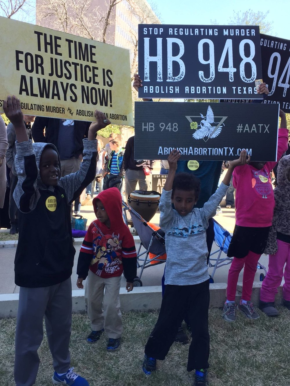 Abolitionist Cody May's sons standing for justice at the HB948 Abolition of Abortion in Texas Act Rally on 2/25/17. Cody went to be with the Lord suddenly and tragically less than a month earlier. He leaves behind his brave wife Kimberly, their seven children (six adopted on missions to Ethiopia) and a legacy of raising the rising generation as the City on a Hill in our darkened culture. CLICK THE PHOTO TO SUPPORT