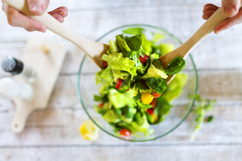 graphicstock-unrecognizable-young-man-in-the-kitchen-preparing-green-salad_H0eCuGsa-b.jpg