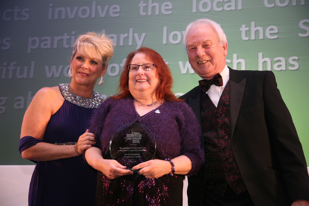 Exceptional Contribution by a Person Living with Dementia, Liz Cunningham, with daily sparkle founder chris harding and host for the night, cheryl baker