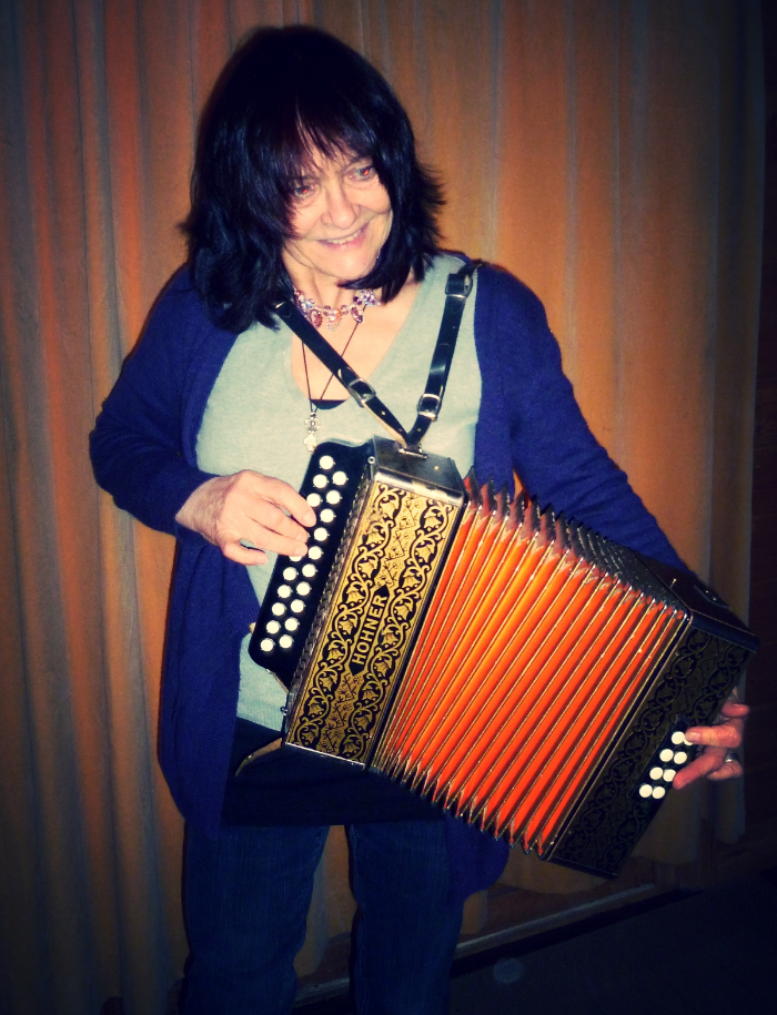 Marion playing her melodeon, which her residents love!
