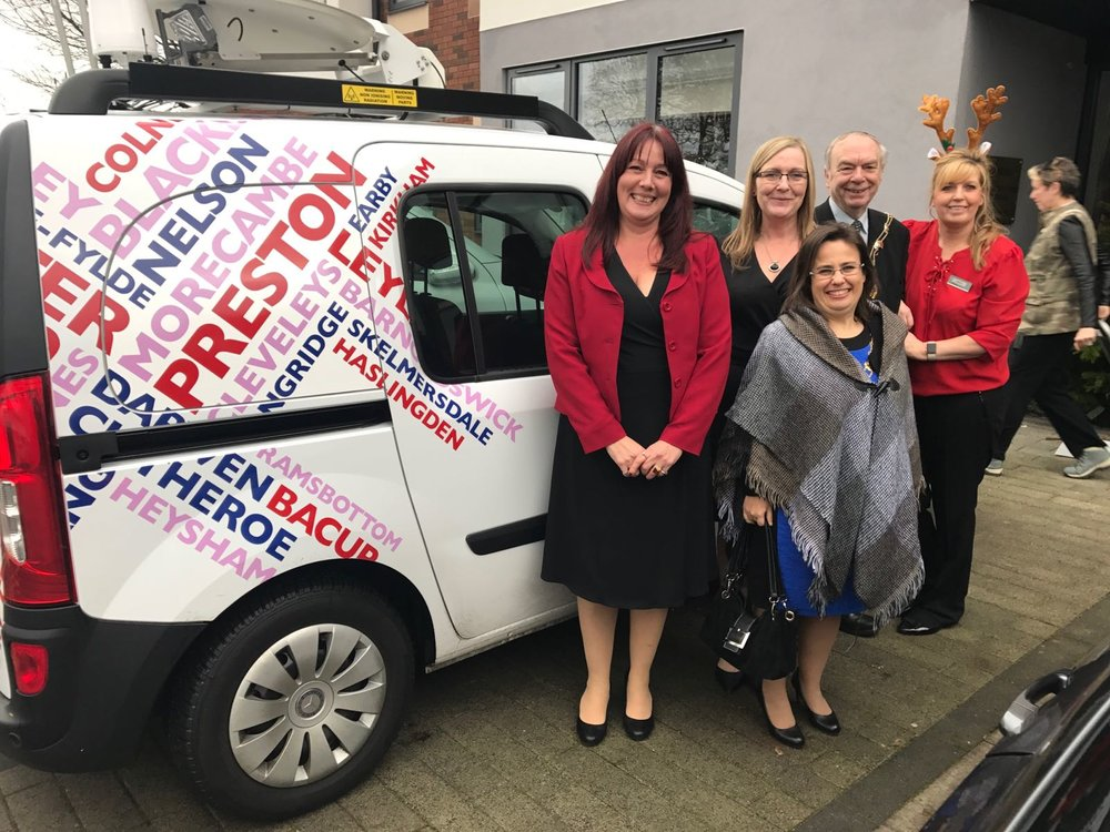 Gaye Clark (in black), and Lesley Malone (with antlers) with local mayor Liz Savage (front) and Radio Lancashire's John Gillmore.