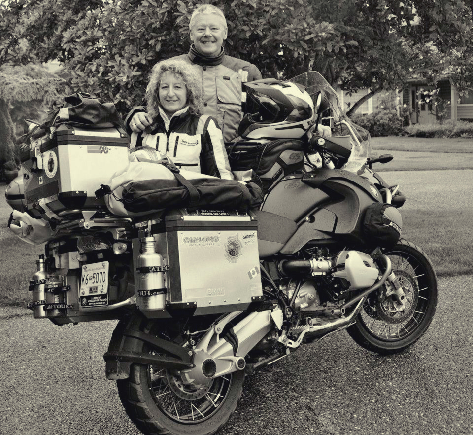 My husband, myself and 'Big Red', the bike that took us around the world!