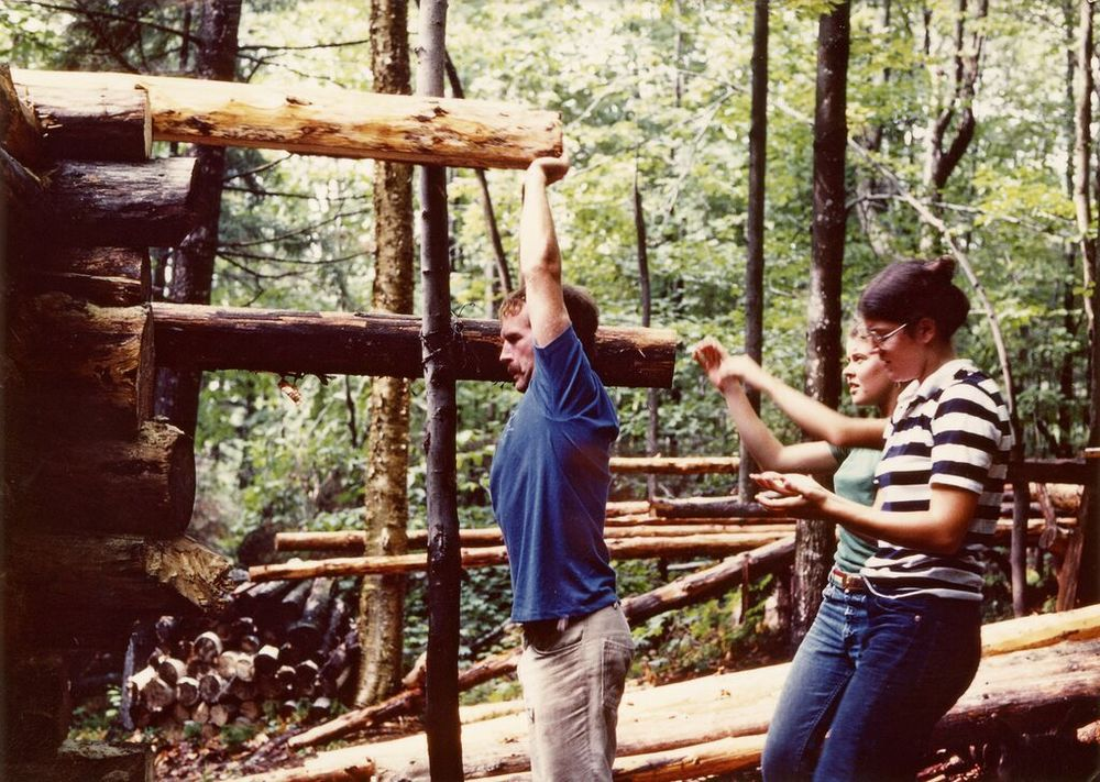 Using a block and tackle from a limb on a large maple behind the cabin (now just a stump) to hoist and position the next wall log. From left to right are Pete Foster, Bob Capers, Peter Kelly, Jim Gaffey, Dave Foster and Mike Foster.