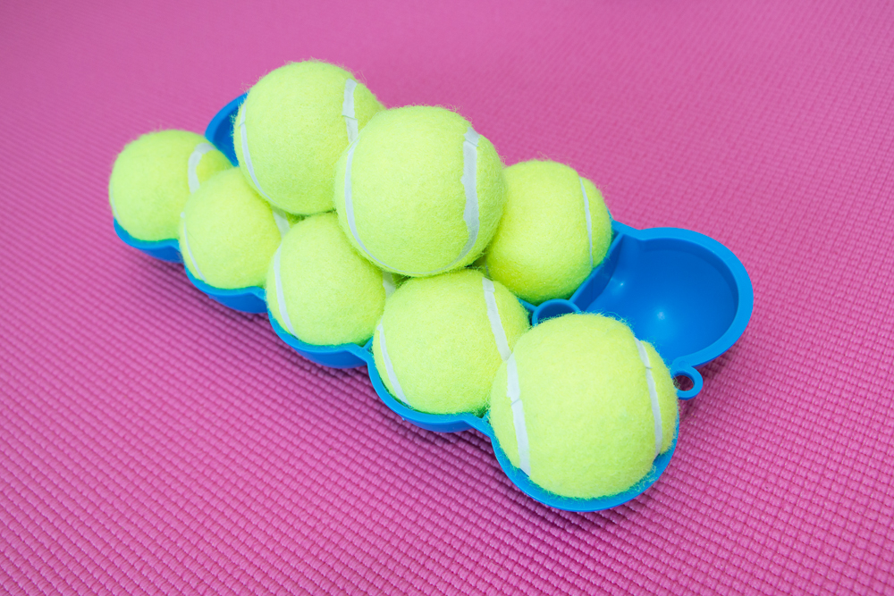 The Back King - Angled Bottom Side 10 Stacked Tennis Balls