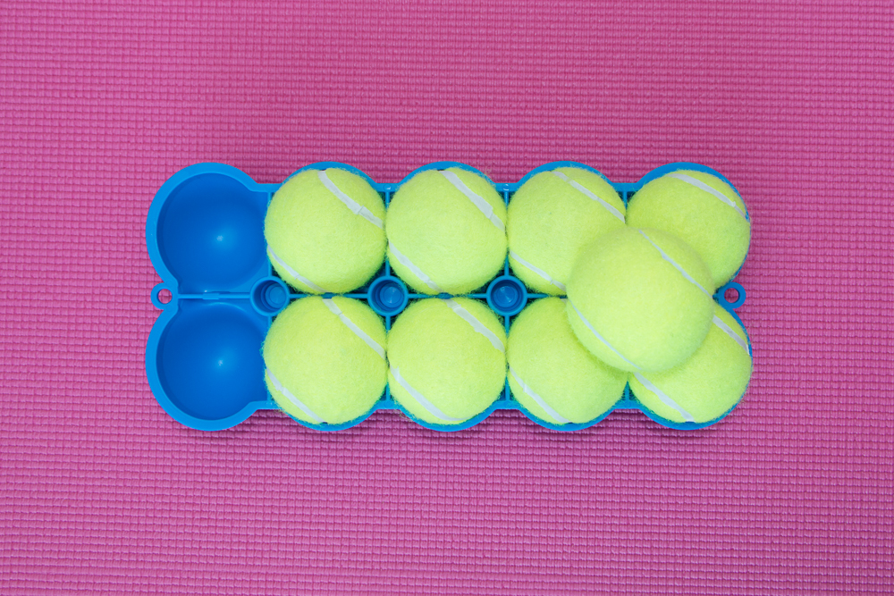 The Back King Bottom Side 9 Stacked Tennis Balls