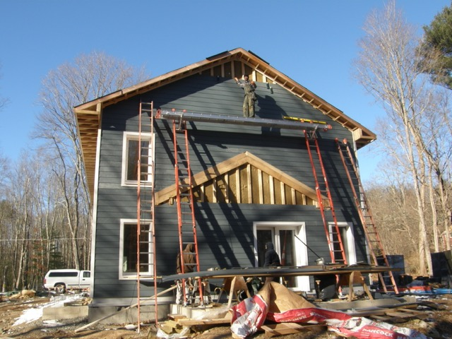 Fiber-cement siding nearing completion.