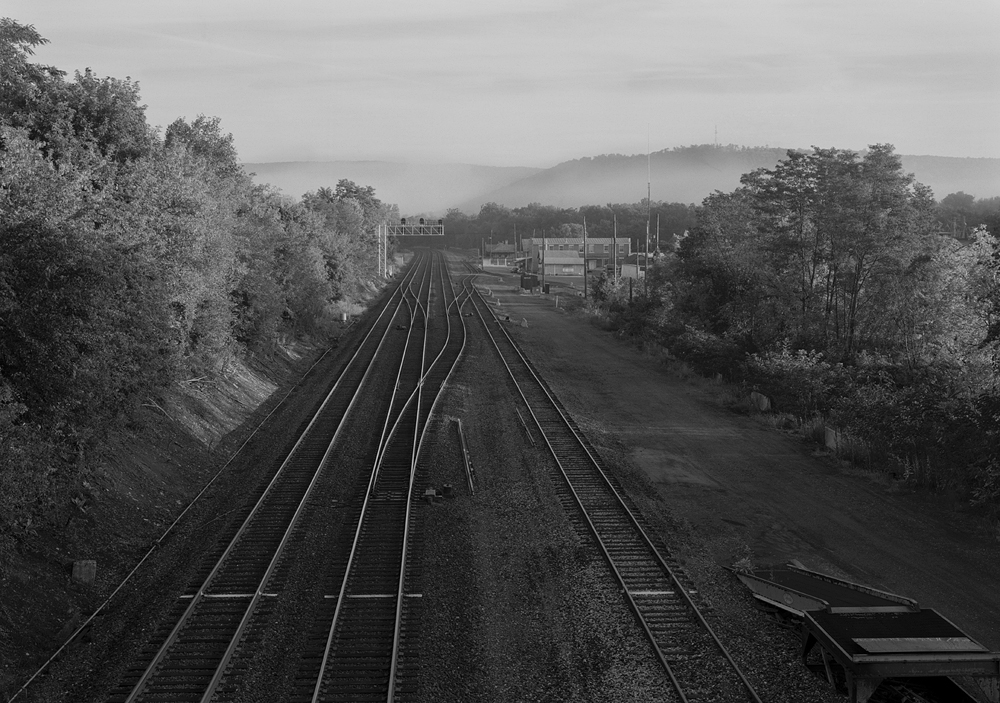 The surviving main line of the Pennsylvania Railroad owes its success to the years of tireless improvements that all began with the charter to build a privately operated railroad connecting Philadelphia to the west in 1846 opening the route between Harrisburg and Lewistown on September 1st, 1849. The Main Line, looking west, Mifflin, Pennsylvania.