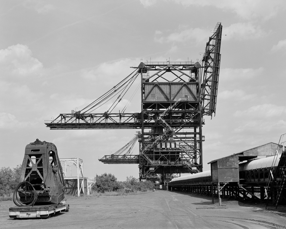 View looking East, Pier 122: this view illustrates the massive ore unloading cranes that have recently been removed from the former PRR facility.