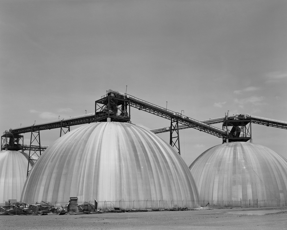 Reinforced Storage Bins: These bins, located in the loading balloon tracks served a large fertilizer storage facility that also received bulk materials via Pier 122.
