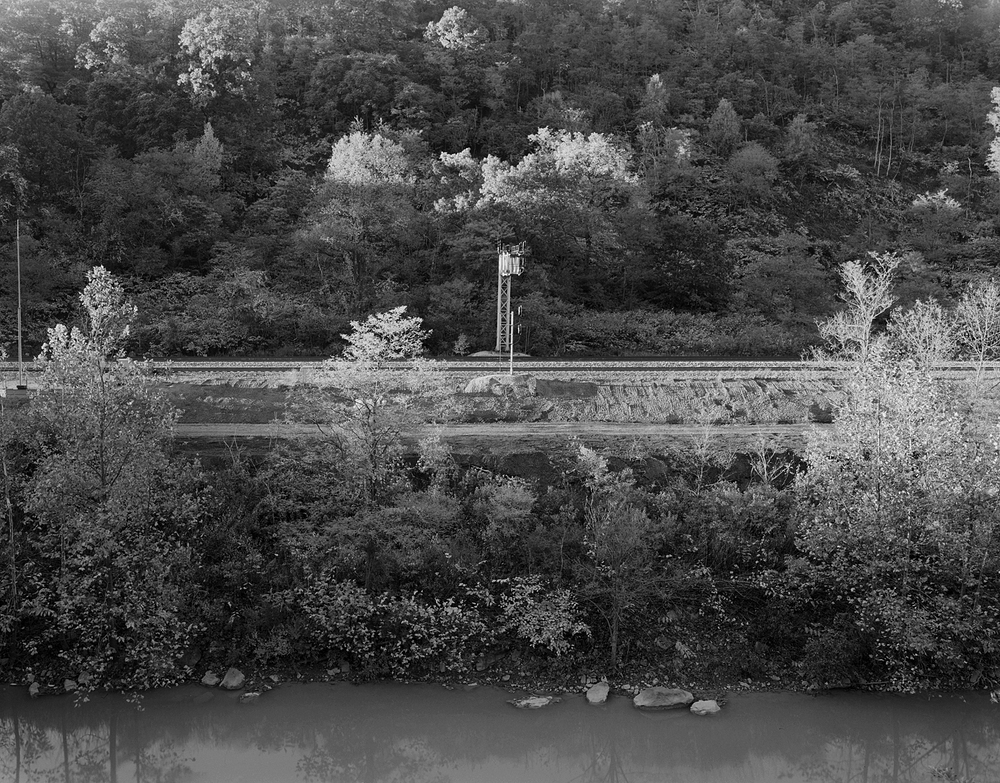 AO interlocking, deep in the Conemaugh River Valley below the Village of Park Hill, was remote controlled by Conemaugh Tower, to facilitate moves of both freight traffic and helper engines into and out of the Woodvale Terminal.