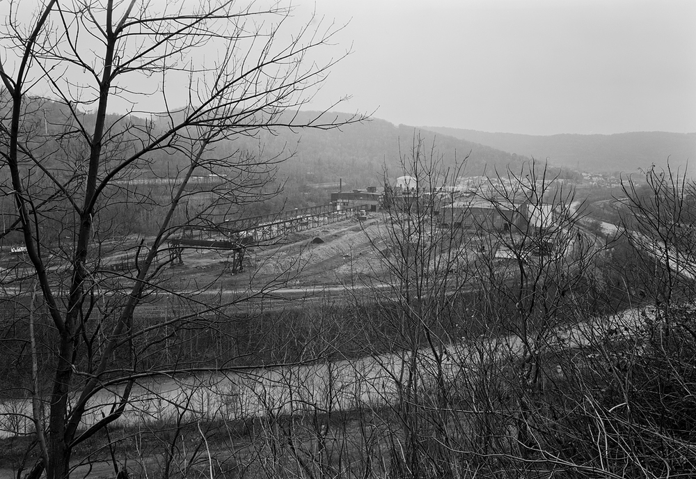 View from the Parkhill area, looking South West into the Villages of East Conemaugh (right) and Franklin, PA (left).  If one examines the image carefully a long unit coal train can be seen snaking along the North (right) side of the Valley. Opposite, image center, is the remains of the Wheel Mill, a part of Bethlehem's now defunct Railcar Division.