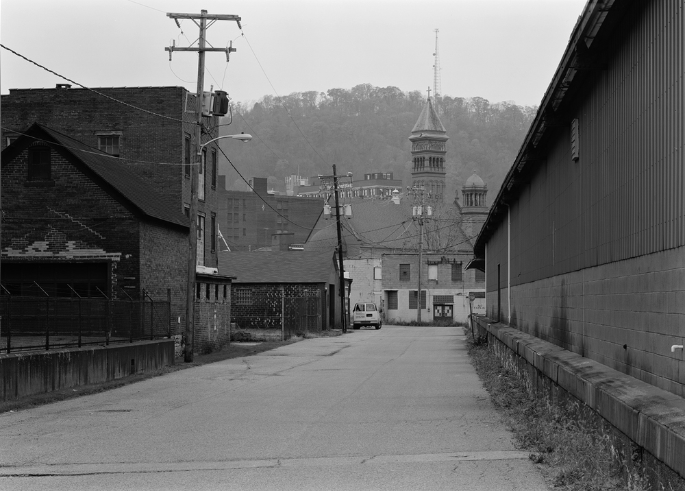 View looking West on Short Street with former S&C Freight House on the right and the Cathedral of Saint John Gualbert standing prominently in the center.
