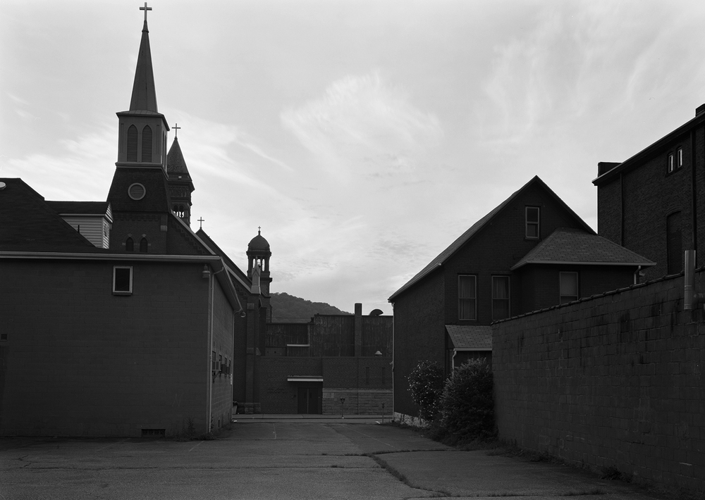 Two Churches are evident in this view from a lot bordering the Former S&C Branch looking Northwest. The Steeple in the foreground belongs to the 1891 Zion Lutheran Church the two further towers are part of the Cathedral of Saint John Gualbert built in 1895.