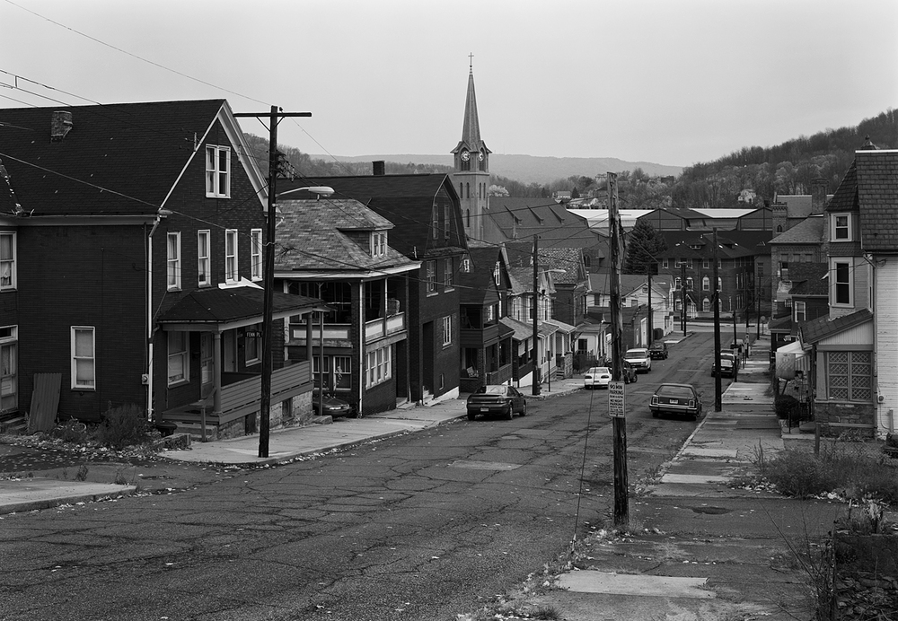 The view from Singer Street in Johnstown, Pennsylvania exemplifies the somber beauty of mill towns across Pennsylvania. Homes cling to the hillsides and business districts look toward the mill, once the focal point to the local economy. Today countless places like Johnstown are a quiet memorial to the era of steel and manufacturing across the region.