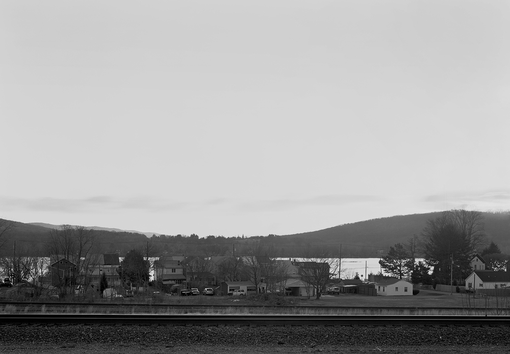 "View of mainline tracks in immediate foreground and distant background. The space in between is the running tracks that connect from Enola Yard to Banks Tower in Marysville about a mile to the west (left). This area was also the original site of the Northern Central's freight terminal, and later auxiliary yard to Enola, used primarily to handle and reverse trains off the Williamsport Line prior to the 1939 installation of the ""B track"" to facilitate moves from the east directly into Enola."