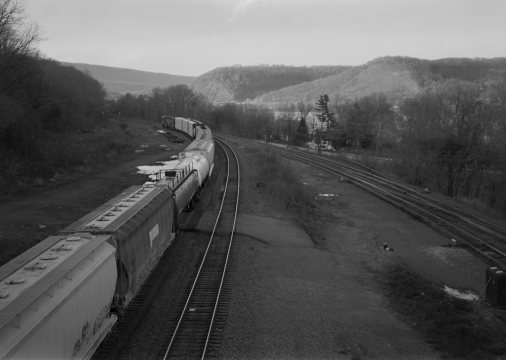 Westbound mixed freight departing Enola from one of five running tracks connecting to the Rockville interlocking complex just to the north.