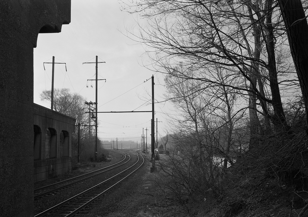View north of Baltimore Old Line tracks, now the only remaining tracks that enter the yard from Norfolk Southern's Enola Branch. Note the remains of the foundation between the catenary poles on the left side of the image, directly in front of the US 11/15 overpass. This is the only remaining evidence of the PRR's Day tower that once controlled the busy south end of the yard.