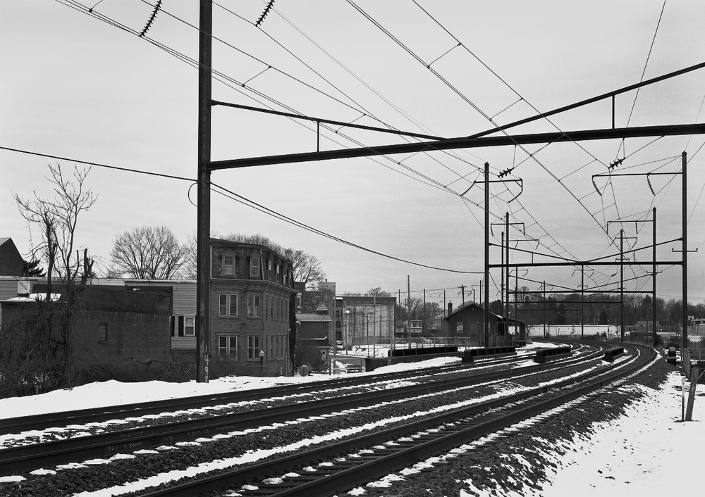 Amtrak mainline and Norfolk Southern Royalton Branch (former Columbia Branch) in the vicinity of the passenger station. Note the former freight station in the distance, which now serves as an antique dealer. The two closest tracks are Amtrak's Keystone line while the furthest is the Royalton branch, a secondary route to move freight off the Columbia and Port Deposit branch directly into Harrisburg.
