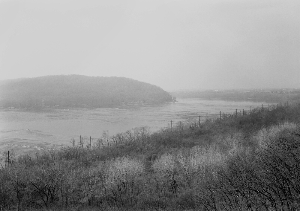 View looking north of Marietta and the York Haven line along the Susquehanna from Chiques Rock, a prominent geological feature which provides a breathtaking view of the river valley. Note the catenary poles here, which still carry a high voltage feeder line from the Safe Harbor Hydroelectric Plant to Amtrak where it supplies catenary power via the substation at Royalton.