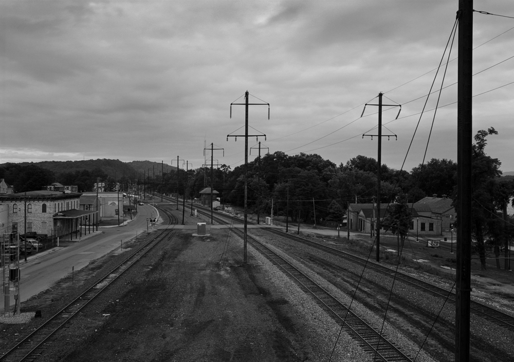 The area of Columbia along Front Street is host to Cola Interlocking. In this view looking east from the Chestnut Street bridge you can view the eastern limits of expansive interlocking which provides access to the original Philadelphia and Columbia Branch to Lancaster (diverging left) with the original Columbia and Port Deposit (mainline to the right). To the west the PRR would become known as the York Haven line or Enola Branch. Note the 1877 PRR station, which survives along North Second Street.