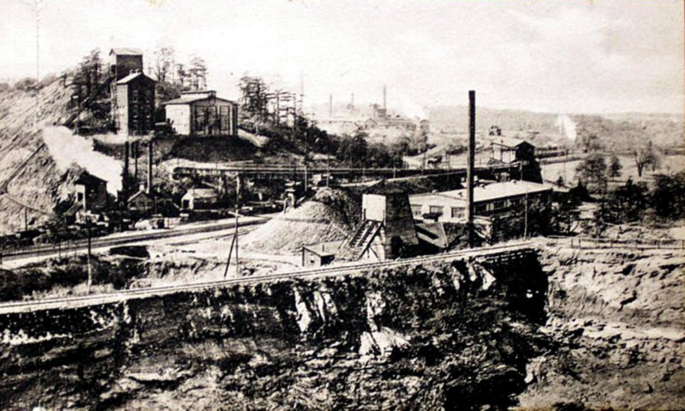 Postcard view of the Cornwall iron ore mines circa 1922. The railroad in the image likely to be the Spiral Railroad, providing access to the three ore bearing hills at the mine site which then fed the material to both the Cornwall Railroad and Cornwall & Lebanon Railroads.