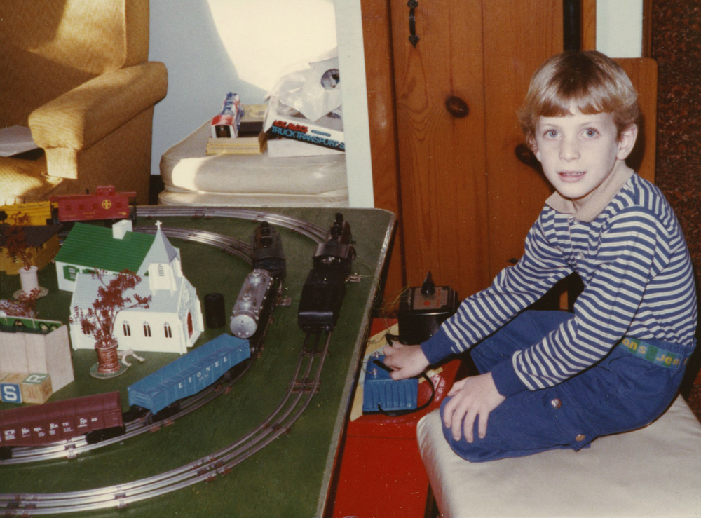 Author's note: Growing up we set up my father's Lionel Trains the weekend following Thanksgiving in a spare bedroom, where I would spend most of my time for the next month and half. In the early 1980's (1982?)   I had a second layout at my grandparents house that stayed up almost year round in the downstairs rec-room. Here is me at the throttle of this layout in a photo dated 1983, I was 7 years old. These experiences were what shaped my imagination and sparked my curiosity of the railroad, both in model and prototype form. The Lionel catalog images are from several originals that were passed on to me through various family members. They still bring about that nostalgic feeling of excitement that came on Saturday morning when we would bring all the Lionel boxes down from the attic, after which my grandfather, father, brother and I would work together to build the train layout  .