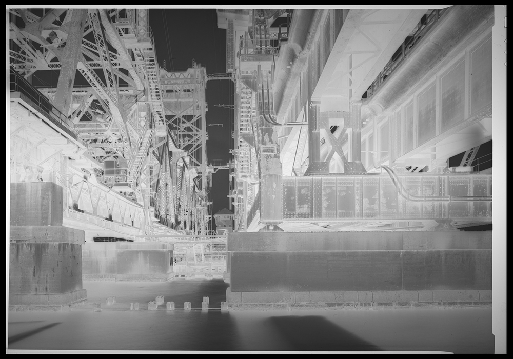 An example of a large format negative from a 5x7 view camera. When properly exposed and developed the negative produce a wide dynamic range in a single negative which can be either scanned or printed traditionally in the darkroom. (Below Left) View Camera film is cut into sheets and loaded into holders like this allowing for two exposures, one on each side. (Bottom Right) My camera of choice is a 5x7 wood field camera, a compact and precise design that affords the benefits of large format without the bulk of a rail design camera. Cassandra, Pennsylvania
