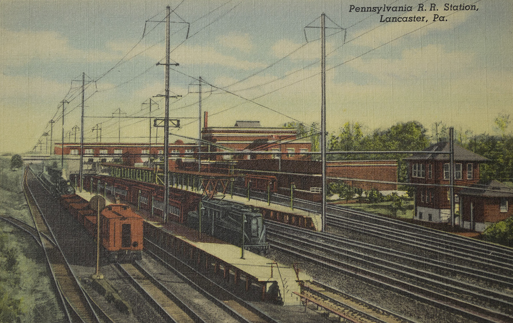 Part of the last wave of Pennsylvania Railroad improvements in the Lancaster area was the 1927 abandonment of the old main line and station through town and the opening of the new passenger station on what was formerly the Lancaster Cut-Off, now essentially the new main line. Further improvements came in 1938 with the completion of the final phase of electrification including the main line from Paoli to Harrisburg, the Low Grade and Columbia branch. Illustrated here in a view looking east is the new station facility and Cork interlocking tower which consolidated control of several interlockings in the Lancaster area. Image collection of the author.