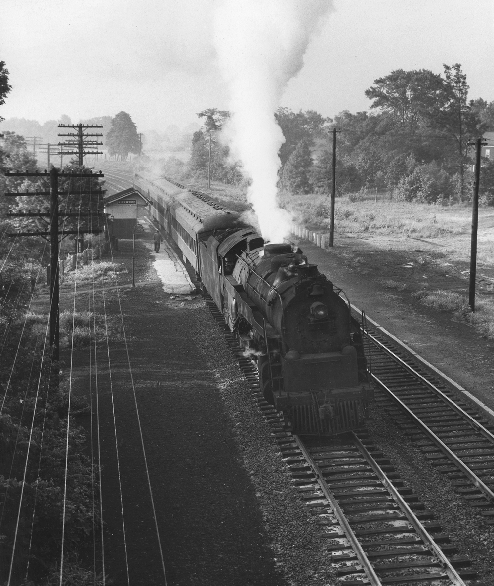 In the Summer of 1954 PRSL local 656 pauses at the Kirkwood Station led by a Reading G class Pacific. Note the depot on the southbound side has been demolished since the view above in 1950. Photography by Robert L. Long, Collection of William Gindhart