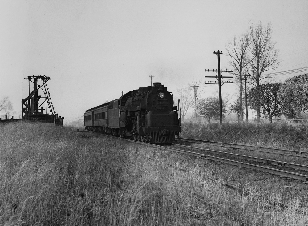 An off season Camden to Hammonton local running via the former Atlantic City Railroad main line crosses Vasser Ave in Stratford, New Jersey, December 6th, 1952. In short time the PRSL will remove the second main track on this line reflecting the diminishing train service on the secondary main line to Atlantic City. Photography by Robert L. Long, Collection of William Gindhart