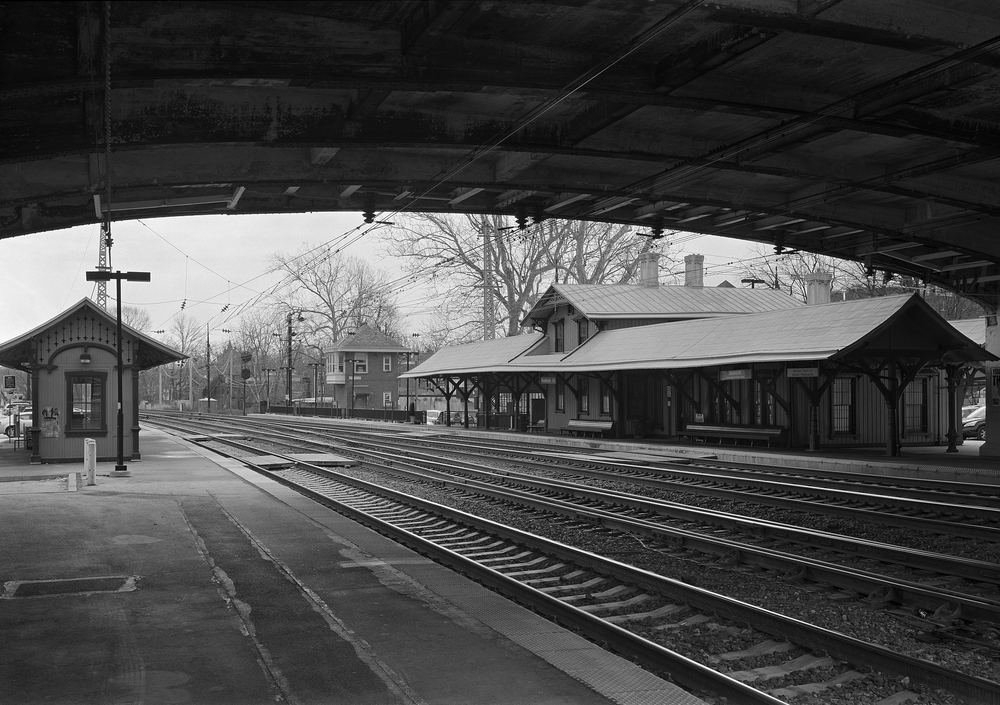 Overbrook Station marks the location where the Pennsylvania Railroad crosses from the Philadelphia city line into the suburban district knows locally as the Main Line. This location is full of PRR character including the station built in 1860, a PRR standard design interlocking tower and the original details from the first phase of the PRR's great electrification project.