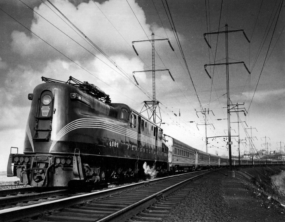 Class GG1 electric locomotive number 4868 pulls The Congressional circa 1965. Amtrak's AEM-7 was the successor of the highly regarded GG-1 both of which had successful careers on the Northeast Corridor, only time will tell if the Siemens ACS-64 will prove to be a worthy replacement.
