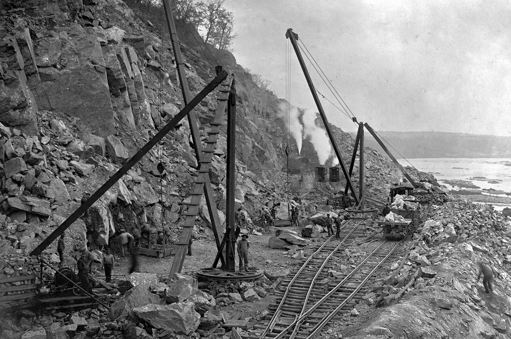 Workers pause for a photograph, likely made by Lancaster based photographer Harry P. Stoner who was commissioned to document the construction of A&S. Blasting, the high cliffs and large loose rock along the stretch in Manor Township presented many hazards to the men while constructing the final few miles of the A&S along the Susquehanna River. Kline Collection, Railroad Museum of Pennsylvania, PMHC