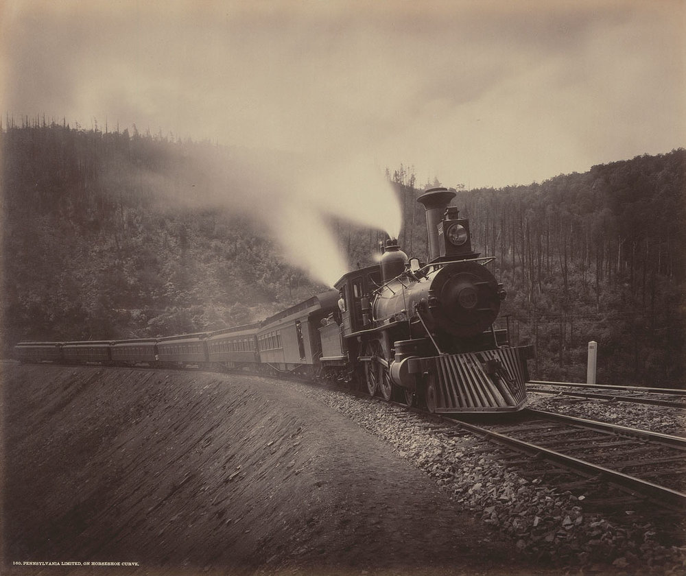 The pinnacle of 19th Century steam is depicted here in 1891, leading the Pennsylvania Railroad's premier train, The Pennsylvania Limited. While many paid attention to the expansive systems, track, and stations, water and fuel were the essential elements to keep steam-powered locomotives running across the road. William H Rau Photograph, Collection of American Premier Underwriters, Inc.