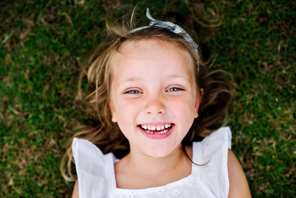 Smiling girl family photography