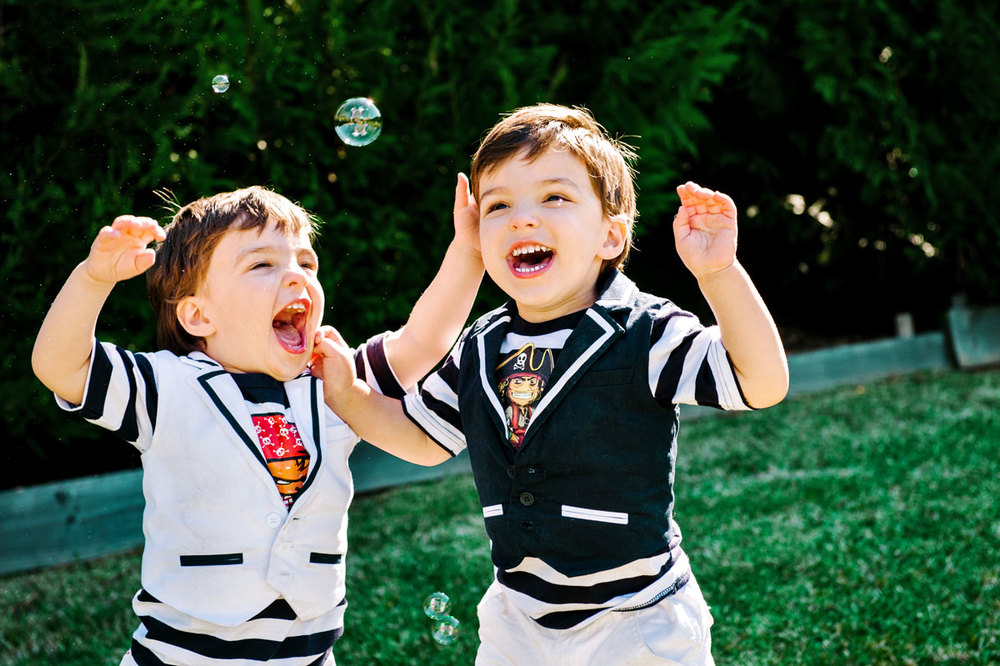 Twin boys laughing
