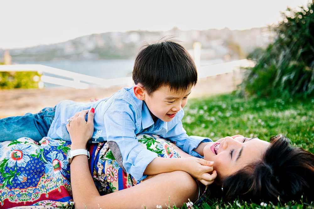 Boy and mother laughing
