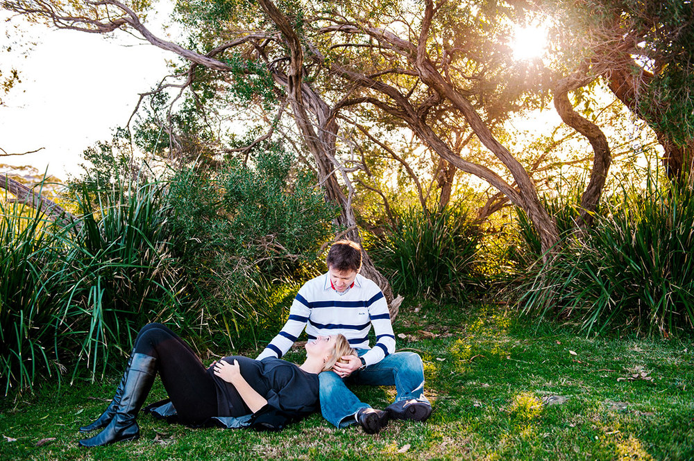 Couple lying on the grass during maternity session