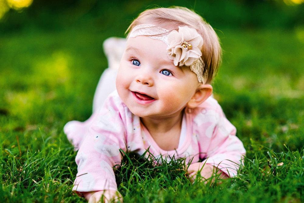 Baby girl smiling at Putney Park
