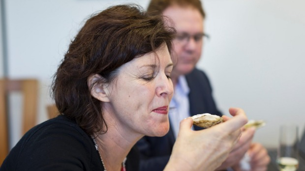 Elizabeth Bean tries a Kiwa oyster at Kono New Zealand yesterday.
